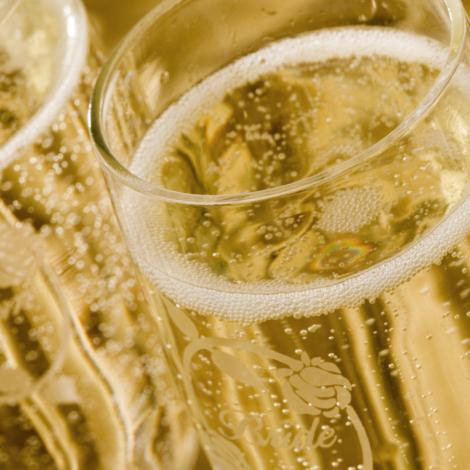 Champagne filled wedding glasses